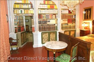 Library in Main Bedroom - an Interesting Collection in this Old Library. Secret Entrance to Sitting Room
