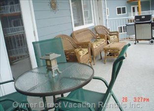 Over-sized Deck with Lots of Seating and Weber Barbecue