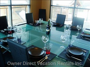 Our Dining Room Table:  Solid Glass (as are the Table's Extensions).