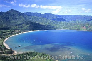 Hanalei Bay Beach - Named Best in USA in 2009 - what a Beach, 3 Miles Long and Great for Adults and Children, no Deep Drop Offs and Clear with many Parking Lots along the Beach. Go for all Day as you Are Next to Hanalei Town and Can Shop and Eat There for Lunch, Etc.