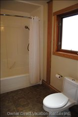 Main Floor Bathroom  - Bathtub and Shower, Washer and Dryer in Closet (Not Shown).