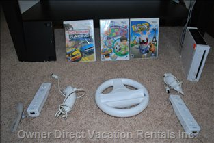 Wii Game - Wii Console with Two Remotes and Nuchucks & Selection of Games in the 3rd Bedroom. you Can Also Watch Netflix on It.