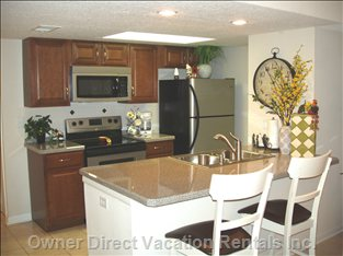 How about a Stainless Steel Kitchen, Cherry Cabinets and a Spectacular Counter-top/Breakfast Bar? it'S all New!