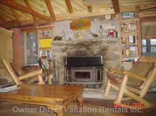 Log Rocking Chairs by Massive Stone Gas/Wood Fireplace
