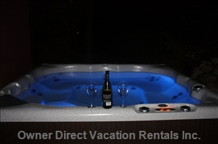 Enjoy some Wine in the Private Secluded 8 Person Hot Tub.
