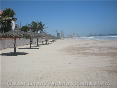 World Class Beach - Beach and Palapas Immediately in Front of our Beachfront Condominium Building.