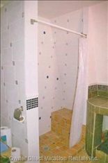 Upstairs Bathroom View of Shower with Seat.