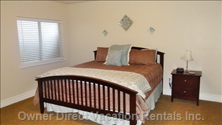 Lower Floor Master Bedroom with King Sized Bed