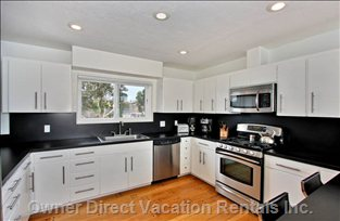 Huge Kitchen - Stocked with Ample Small Appliances and Cookware.