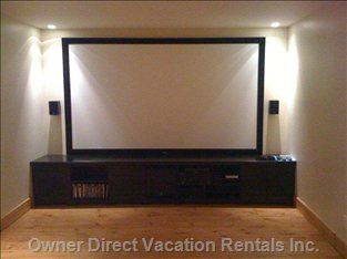 Movie Theatre Room - a Huge Screen with Overhead Projection, Lazyboy Reclining Seats, Bluray Videos, ps3 Video Game, 7.1 Surround Sound.