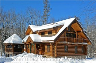 Winter View of House - the House is a Real Winter Playground. Build a Snowfort in the Forest, Or Go Xcountry Skiing and Snowshoeing Right from the Front Door. Great Trails Surround!