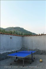"Ping Pong Table with ""Monte Arso"" in the Background"