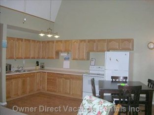 Kitchen - Lots of Cupboards, Fridge,  Microwave & Oven.
