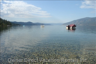 Private Buoy and Beach in Front of Beachouse Suite Property - Crystal Clear Water for Swimming one Minute Walk from your Abode !