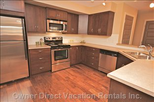 Open, Bright, Kitchen - Enjoy Cooking in this Well Equipped Kitchen with Shiny, Bright, Stainless Steel Appliances.