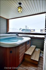 Another Hot Tub Shot with Village and Monashee Mountains Viewed off the Deck