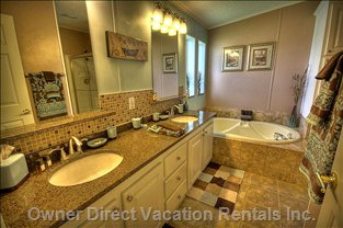 Elegant Master Bath with Double Vanity Granite Counter Tops