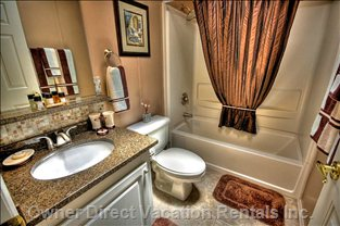 Family Bathroom with Granite Counter Top, Full Bed and Rainfall Shower Head