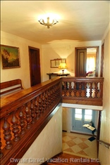 The Upper Stair Leads to the Second Floor. The Property is Kid Friendly: High Chairs, Cribs and Stairgates are Available upon Request