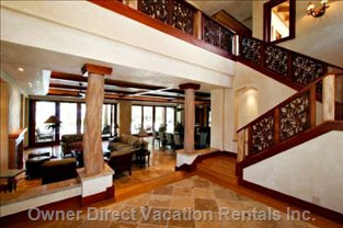 Lovely Foyer Entry with Custom Balinese Handrails Staircase