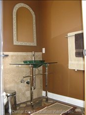 Powder Room Adjacent to the Living Room