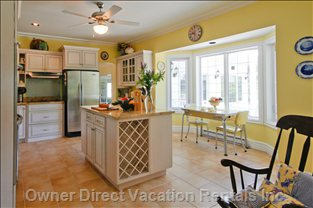 Kitchen - Countrified and Comfortable Kitchen Provides the Focus for Family Activities at the Table Or around the Island.