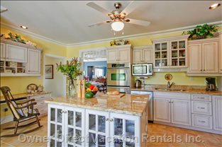 Kitchen - Warm and Welcoming, this Large and Friendly Kitchen with French Doors is a Warmth of Light Colors and Abundant Counter Space.