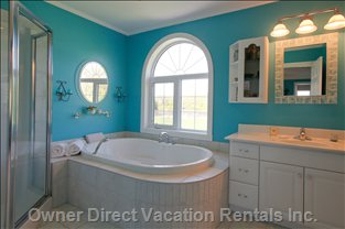 Master Bedroom Ensuite - a Lavish Bath with Whirlpool, Shower, and Windows Looking onto Rear Lawns and Tennis Courts.  Beauty, Glamor and Function Combined!  Entrances to the Ensuite from the Bedroom and the Private Master Sitting Room.