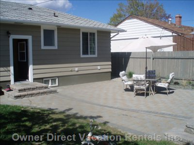 Backyard: Fully Landscaped and Fenced - Large Backyard for those Summer Days and Nights