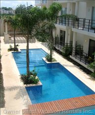 Beautiful Garden Courtyard and Great Pool with a Shallow End for Young Kids and a Shaded Cabana for Relaxing Or Reading out of the Sun
