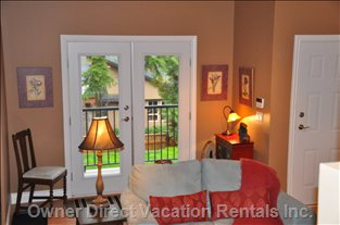 French Doors Lead into the Living Room off the Private Deck. - There Are Two Doors to the Suite. the French Doors into the Living Area and a Single Door that Leads to the Kitchen.