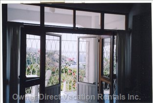 Double Door Entrance with Screen Doors to Balcony