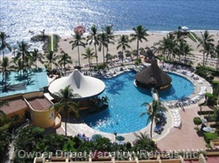 View from Private Balcony of the Holiday Inn Pool, Beach & Ocean. - Large Beach-side Swimming Pool, Palapas on the Beach for Guests to Use. Free Beach Towels Daily, Separate Sun Tanning Area, Away for Beach Vendors