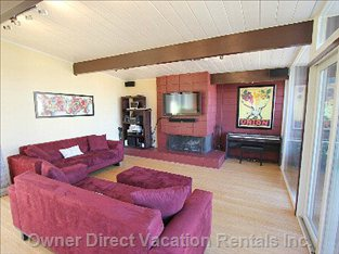 Living Room with Working Gas Starter Equipped Fireplace and 42 Inch Plasma High Definition TV