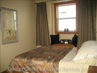 Main Bedroom - En Suite Facilities.  Two Bedside Cabinets and Built in Wardrobes.  Views Looking up to Ski Runs
