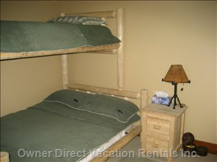 Second Bedroom. Double Bed with Upper Single Bunk. One Bed Side Cabinet.  Built in Wardrobes & Small Chest of Drawers