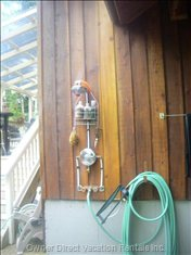 Outdoor Shower - Outdoor Shower with Hot Water. Also Really Handy to Wash Sand off Everyones Feet before Heading up to the Outdoor Living Space.