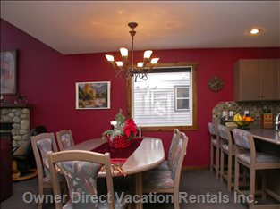 Dining Area - the Dining Area is Ideally Located beside the Kitchen and Incorporates an Eating Bar with Backrest Stools.  Matching Timber Dining Table, Chairs and Stools Continue a Lovely Theme.  the Kitchen Also Includes another Eating Bar with an Additional Four (4) Stools.