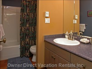 Bathroom #2 - Full - this Bathroom Offers a Fully Featured Washroom with Vanity and Cupboard, Illuminated Mirror, Shower as Well as Full Size Bath TUN and Toilet.  a Hair Dryer, Soaps and Towels Are Also Provided.