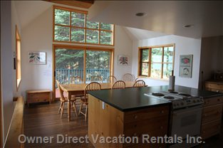 Dining Room - Kitchen Island in Foreground and Deck with Hot Tub beyond