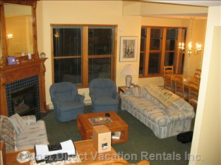 Livingroom and Dining Room - the Living Room has High Vaulted Ceilings and a Gas Fireplace to Keep you Cozy. the Dining Room is a Great Place for Entertaining with Place Settings for Twelve.
