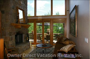 Formal Living Room and Wood Burning Fireplace with View of the Canyons Resort