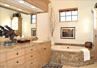 The Master Bathroom has His-and-hers Sinks and a Garden Tub.