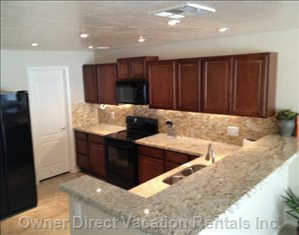 New Kitchen with Large Fridge with Ice Maker Granite Counter Tops Dish Washer and Eating Bar