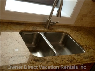 Double Sink with Pullout Faucet in Front of Large Window