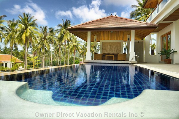 Luxurious modern villa with large garden, spacious pool and tropical sea and island views