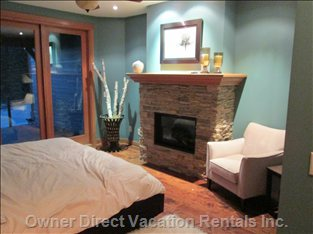 Master Bedroom - Gas Fireplace, 9 Foot Custom French Doors; Ensuite  with Roman Tub,  Private Balcony, King Size Bed, Walk in Closet.