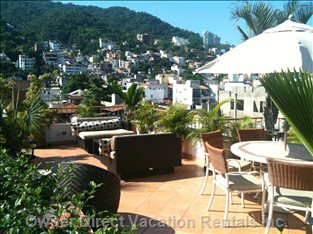 Rooftop Terrace Accessible by all Units. View of the Hills, Mountains and the City.