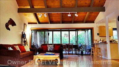 Spacious Living Room - with High Ceilings & Cozy Couches to Lounge In. There is a Lanai on both Sides of it