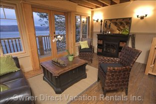 Fireplace in Living Room with Deck with Lake View.